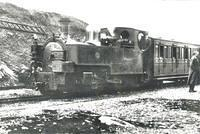 b/w photo of Russell & train at Bedgelert