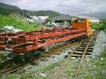 two new steel carriage chassis stacked on a freight train