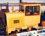 side view of the bright yellow loco in the shed