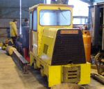 front view of the bright yellow loco in the shed