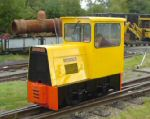 bright yellow loco running through the yard