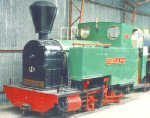 green steam locomotive in shed